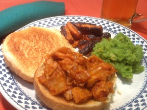 "BBQ ""pork"" sandwich with roasted carrots,  mushy peas, and a nice cool beer."