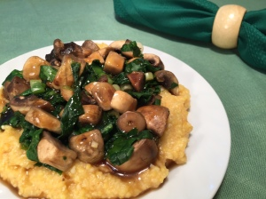 Polenta topped with mushrooms and spinach