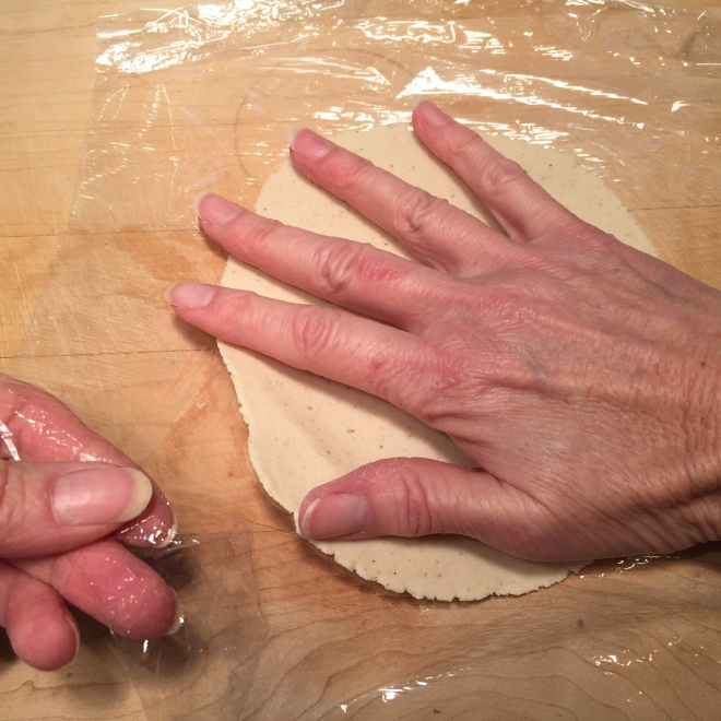 corn tortilla hand on dough